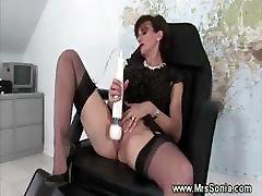 Older teacher uses massagetoy at office