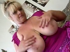 Busty MILF Jessika Mature.NL Strips and uses her toy on the sofa.