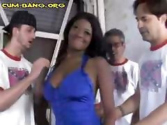 Busty ebony babe is in a blowbang with all white cocks to suck