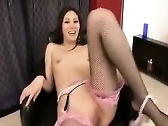Sexy slender Asian beauty shows off her footjob and handjob