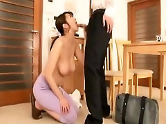 Big breasted Asian wife kneels down and drives a hard dick