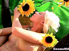 Flexible enema babe squirting milk out of ass