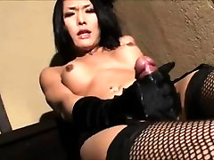 Asian Tranny strokes her cock to orgasm