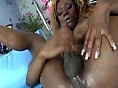 Busty black bikini tranny toying her ass