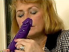 Small titted blonde mature dildoing her pussy