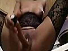 horny ebony from BlacksCrush.com fucking herself and squirting in the kitchen