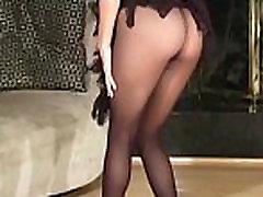 Hirsute pussy in black tights