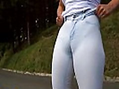 Walking around the city flashing her cameltoe in sexy tight jeans
