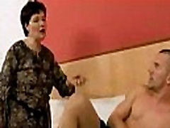 Mature brunette fucking her pussy