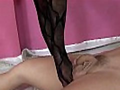 Domme teases her slave with a footjob in her black stockings