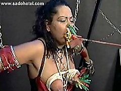Tied up scared slave with alot of clamps on her face and tits got hit with stick
