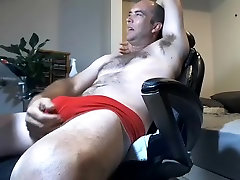 Alluring male is having fun within doors and filming himself on web camera