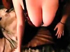 Big breasted cutie sucks to cum on her breasts