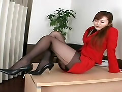 Asian hottie wears a red dress and black stockings