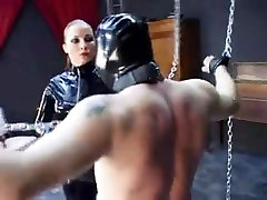 Two scenes: Dominatrix spanks, slaps, spits on sub