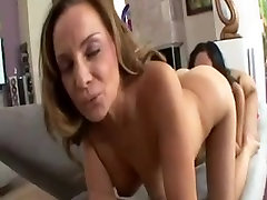 Busty lesbian MILF licks and fingers a horny tramp