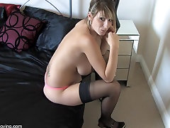 Blonde slut in stockings teases with a down blouse flash