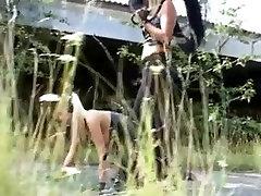 Golden-Haired Fetish-Doxy Kathleen in bizzare Outdoors-Scene