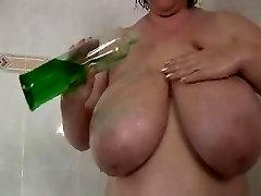 BBW slut plays while taking a shower