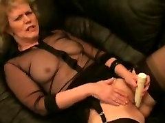 Masturbating mature in stockings