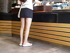 Pantyhose Saleswoman in Shiny Tan Pantyhose