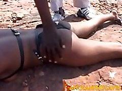 Punishing ebony brunette babe outdoors