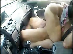 Asian couple having sex in car