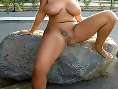 Mature with big tits pissing in public