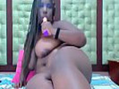 Cute horny ebony doll with curvaceous body and huge tits