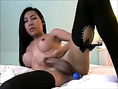 Oriental Ladyboy with a Dildo in Her Ass
