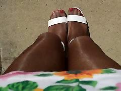 Sexy Shiny Pantyhose Legs Outdoors