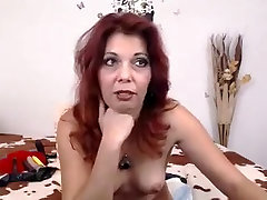 Naughty Redhead Milf Displays Her Perky Breasts And Enjoys