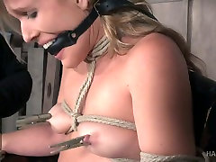 Sluttishly looking blonde Sasha Heart is tied up and punished in the rebecca bardaoux room