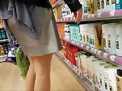 Sexy shopper in shiny tan pantyhose with mini skirt