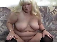 MATURE LADY LEG SPREADING ON THE COUCH