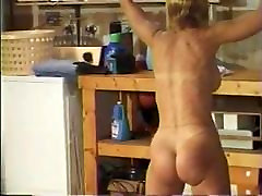 Whipped naked woman in the garage
