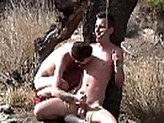 Charley Cole slaps restrained twink Reece Bentley outdoors