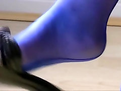 Dangling high heels and electric blue seamed stockings