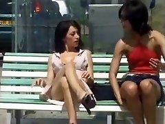 Pussy flashing upskirt babes on park bench