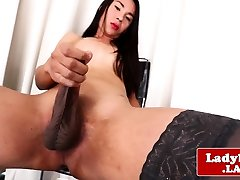 Glamcore ladyboy tugs her dick until climax