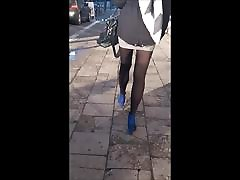 75 Sexy brunette with long legs in mini skirt and pantyhose