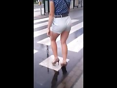 85 Woman with sexy legs in shorts and high heels