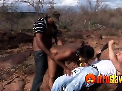 Ebony sex slave is disciplined outdoors