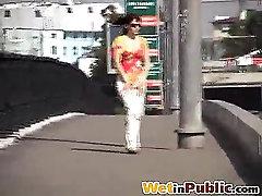 Slut pulls down her wet pants in public