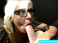 Milf with spex feeds on hard cock