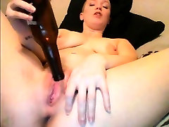 Cute amateur masturbating with a bottle