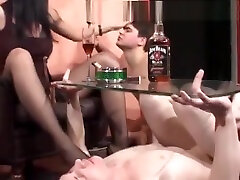 Mistress Enjoys A Cigar And Two Slaves