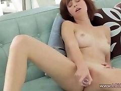 Glass dildo in redhead pussy