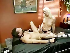 Brunette black queen sits on her slave and humiliates the man in