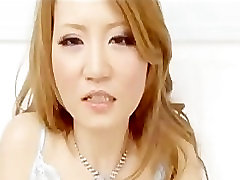 Cute Asian chick in stockings and sexy silk top and panty spreadi